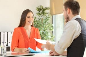 71158793 - woman giving a resume to the interviewer in a job interview